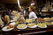 SAN SEBASTIAN - SPAIN - 23 JULY 2010 -- Tapas, or in Basques called pintxos, ready for lunch time at the Casa Alcalde Tapas Bar, San Sebastian. PHOTO: ERIK LUNTANG / INSPIRIT Photo.