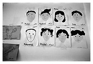 Self-portrait children?s drawings on the wall of the Edward Said Musical Kindergarten. Ramallah, Palestine, 2006