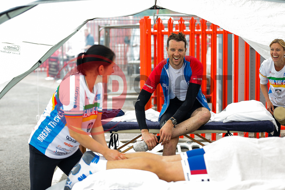 One of the first finishers at Ashton Gate (350) prepares for a massage after Break the Cycle, a 110 mile charity bike ride organised by the Bristol, Bath and Gloucester Rugby Community Foundations, visiting their respective stadia, Ashton Gate, The Recreation Ground and Kingsholm Stadium - Photo mandatory by-line: Rogan Thomson/JMP - 07966 386802 - 14/06/2015 - SPORT - Cycling - Bristol, England - Ashton Gate Stadium.