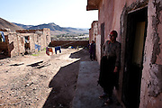 """Maria (right), 44 years old, and Kadija (back), age 28, are two sex workers who live in an old souk, Tamsult, that had just gone out of business in the '80s, at 1200 mt of altitude. This desolated place is known by all as the crossroads for sex. A group of sex workers occupy the walled and abandoned boutiques. Most of the whores, in the maroccan mountains, live around souks, the main places for any kind of business..January 2010, Tamsult, Anti-Atlas mountains, Morocco.....The misery of a square bare, dirt, dotted with broken glass and cans, brick structures close the doors of old shops, stray dogs and the ghosts of women who inhabit it. Are Taidit, are """"bitches"""", are prostitutes and are the renters of an old souk abandoned at 1200 meters in the heart of the Anti-Atlas Mountains of Morocco. The time when the market was full of merchants and sellers gave place to the vendors of their own bodies...To protect the identities of the recorded subjects names are fictional."""
