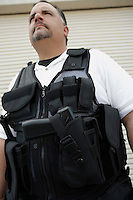 Portrait of security guard in bulletproof vest