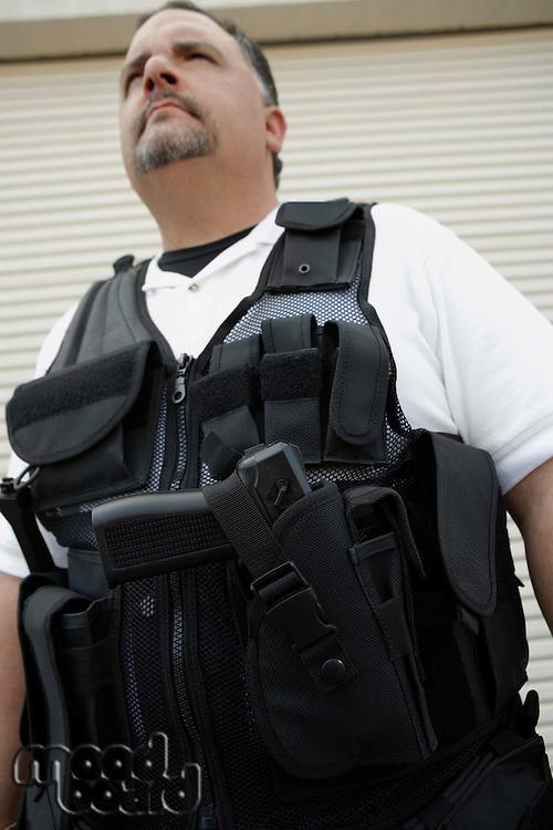 Portrait of security guard in bulletproof vest