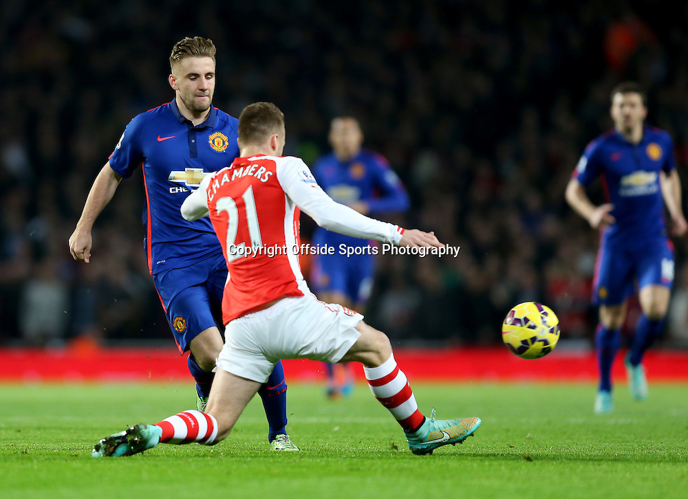 22 November 2014 - Barclays Premier League - Arsenal v Manchester United - Luke Shaw of Manchester United in action with Calum Chambers of Arsenal - Photo: Marc Atkins / Offside.