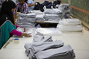 C&A clothes being packaged up ready for collection from an Epyllion Group factory in Bangladesh.
