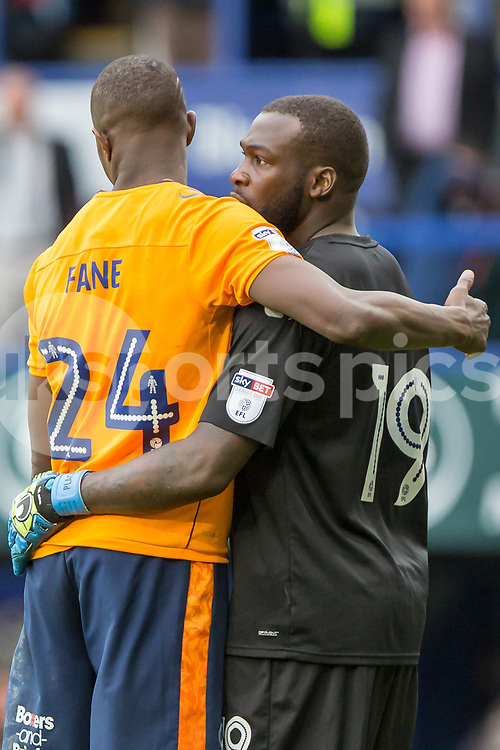 Ousmane Fane of Oldham Athletic congratulates Johny Placide of Oldham Athletic on winning the EFL Sky Bet League 1 match between Portsmouth and Oldham Athletic at Fratton Park, Portsmouth, England on 30 September 2017. Photo by Simon Carlton.