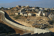 The wall separating Israel (left) and Palestine (right), also known as the security fence cuts through communities in Jerusalem and throughout the West Bank.