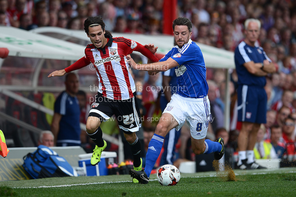 Jota of Brentford (l) and Cole Skuse of Ipswich Town compete for the ball. Skybet football league Championship match, Brentford v Ipswich Town at Griffin Park in London on Saturday 8th August 2015.<br /> pic by John Patrick Fletcher, Andrew Orchard sports photography.