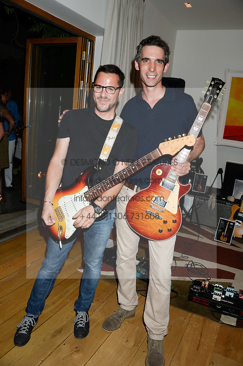 Left to right, PHIL HYLANDER and MICHAEL ROSS partners in Notting Hill Guitars at an Evening with Notting Hill Guitars held at 167 Westbourne Grove, London W11 on 4th September 2013.