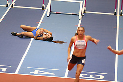 March 2, 2018 - Birmingham, United Kingdom - Elisavet Pesiridou (Greece) lies on the track in pain after falling hard during the IAAF World Indoor Championships women's 60m hurdles. (Credit Image: © Hurdles-5.jpg/SOPA Images via ZUMA Wire)