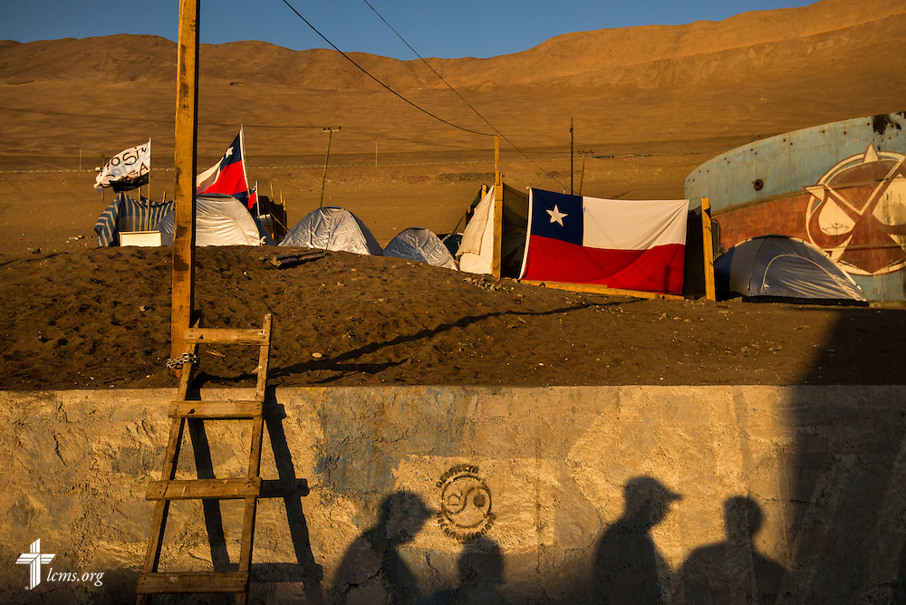 Members of the LCMS Disaster Response team survey a cluster of displaced families living in tents on Wednesday, April 23, 2014, in Iquique, Chile. A magnitude 8.2 earthquake struck on April 1, 2014, approximately 95km northwest of Iquique. The earthquake condemned several thousand homes and severely damaged more than 10,000 others. LCMS Communications/Erik M. Lunsford