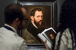 "© Licensed to London News Pictures. 29/11/2019. LONDON, UK. Technicians inspect ""Portrait of Jacopo da Trezzo"", by Anthonis Mor (Est. GBP300-500k) at the preview of Old Masters sales at Sotheby's, New Bond Street.  Works will be offered for sale on 4 and 5 December.  Photo credit: Stephen Chung/LNP"