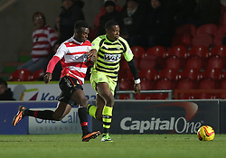 Yeovil Town's Liam Davis beats Doncaster Rovers' Theo Robinson for pace - Photo mandatory by-line: Matt Bunn/JMP - Tel: Mobile: 07966 386802 22/11/2013 - SPORT - Football - Doncaster - Keepmoat Stadium - Doncaster Rovers v Yeovil Town - Sky Bet Championship