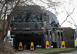 © Licensed to London News Pictures. 15/03/2018. Alderholt, UK. A vehicle loaded on to the back of a military vehicle is seen at an address in Alderholt, Dorset, believed to be the home of Wiltshire Police Detective Sergeant Nick Bailey, in connection with the poisoning of Former Russian spy Sergei Skripal and his daughter Yulia were. The couple where found unconscious on bench in Salisbury shopping centre. Photo credit: Ben Cawthra/LNP