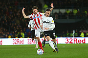 Derby County forward Tom Lawrence (10) goes past Stoke City midfielder Joe Allen (4) during the EFL Sky Bet Championship match between Derby County and Stoke City at the Pride Park, Derby, England on 13 March 2019.