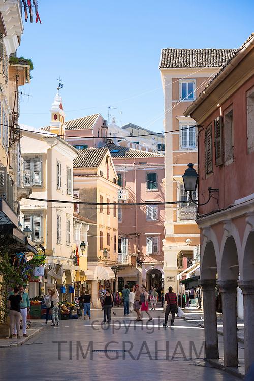 Tourists and local people in street scene in Kerkyra, Corfu Town, Greece