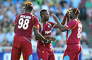 Andre Russell of the West Indies celebrates with teammates after getting the wicket of Faf du Plessis of South Africa during the 2015 KFC T20 International game between South Africa and the West Indies at Newlands Cricket Ground, Cape Town on 9 January 2015 ©Ryan Wilkisky/BackpagePix