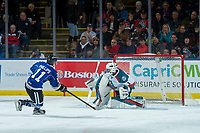 KELOWNA, CANADA - FEBRUARY 12: Matthew Phillips #11 of the Victoria Royals scores a penalty shot on James Porter #1 of the Kelowna Rockets during the first period on February 12, 2018 at Prospera Place in Kelowna, British Columbia, Canada.  (Photo by Marissa Baecker/Shoot the Breeze)  *** Local Caption ***
