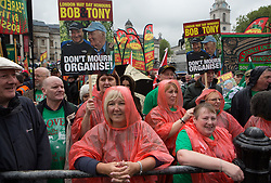 Occupy Wonga May Day. A protester wearing ponchos holding Bob and Tony banners at Trafalgar Square on the annual May Day march. Central London, United Kingdom. Thursday, 1st May 2014. Picture by Daniel Leal-Olivas / i-Images
