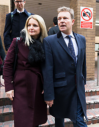 © Licensed to London News Pictures. 09/01/2019. London, UK.  Craig Mackinlay with his wife, Kati leave Southwark Crown Court after he was cleared of breaking electoral expenses rules in his 2015 general election campaign.  Photo credit: Vickie Flores/LNP