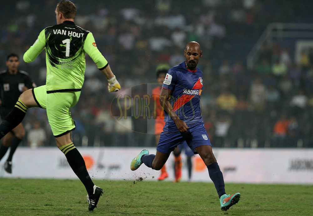 Nicolas Anelka of Mumbai City FC tries to get past Kristof Van Hout of Delhi Dynamos FC during match 22 of the Hero Indian Super League between Mumbai City FC and Delhi Dynamos FC City held at the D.Y. Patil Stadium, Navi Mumbai, India on the 5th November.<br /> <br /> Photo by:  Vipin Pawar/ ISL/ SPORTZPICS