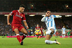 Alex Oxlade-Chamberlain of Liverpool crosses under pressure from Tom Ince of Huddersfield Town - Mandatory by-line: Matt McNulty/JMP - 28/10/2017 - FOOTBALL - Anfield - Liverpool, England - Liverpool v Huddersfield Town - Premier League