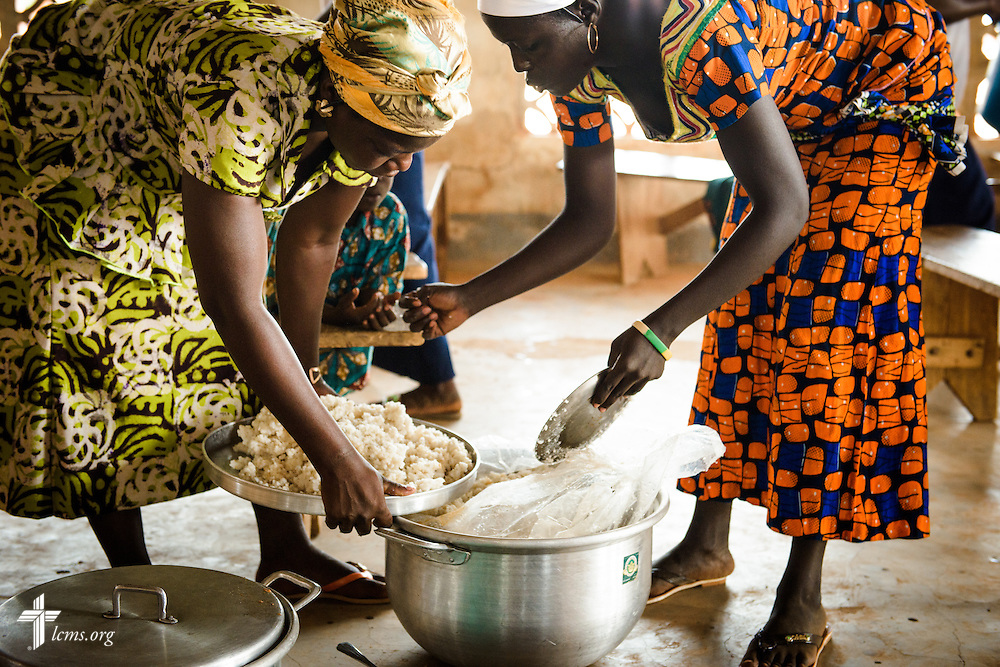 Church members prepare food for fellowship following worship at the Lutheran Church of Togo in Mire on Sunday, Feb. 12, 2017, in Mire, Togo. LCMS Communications/Erik M. Lunsford