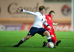 LLANELLI, WALES - Saturday, September 15, 2012: Wales' Hayley Ladd in action against Scotland's Megan Sneddon during the UEFA Women's Euro 2013 Qualifying Group 4 match at Parc y Scarlets. (Pic by David Rawcliffe/Propaganda)