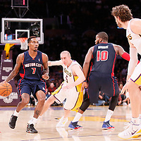 17 November 2013: Detroit Pistons point guard Brandon Jennings (7) drives past Los Angeles Lakers point guard Steve Blake (5) on a screen set by Detroit Pistons power forward Greg Monroe (10) during the Los Angeles Lakers 114-99 victory over the Detroit Pistons at the Staples Center, Los Angeles, California, USA.