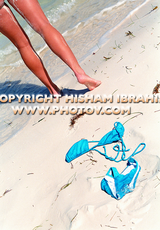 Woman walking naked on beach