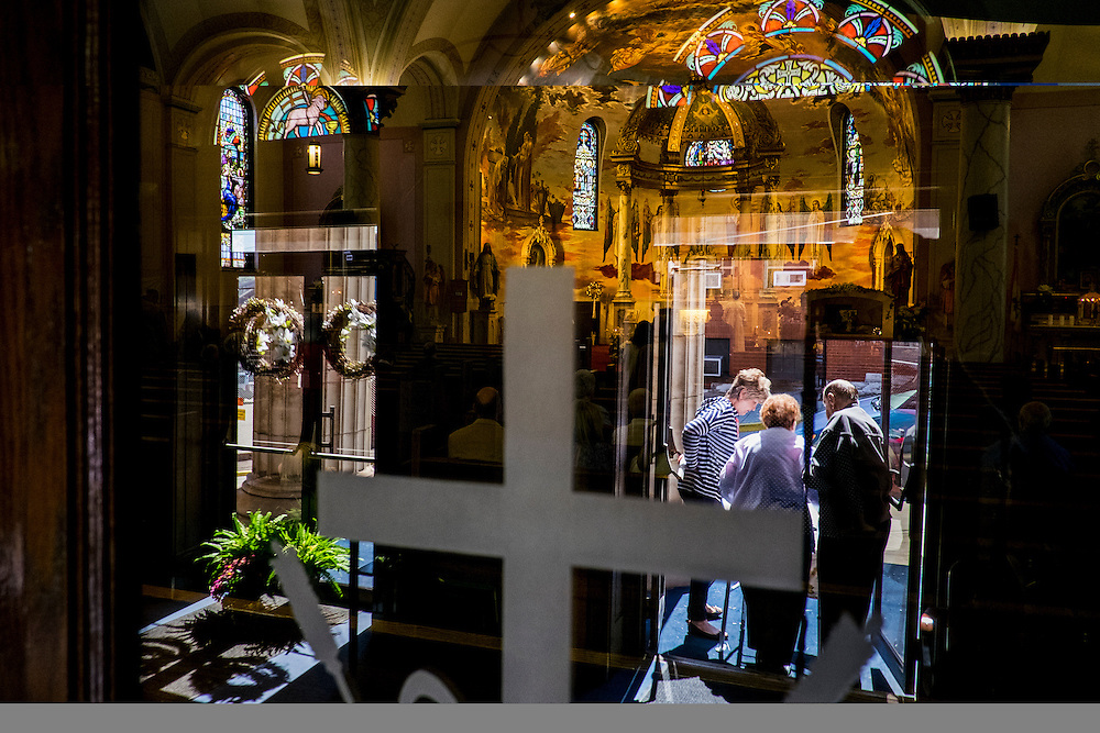 Parishioners leave following a Sunday service at Saints Peter and Paul Byzantine Catholic Church in Braddock, Pennsylvania, USA on September 24, 2016.