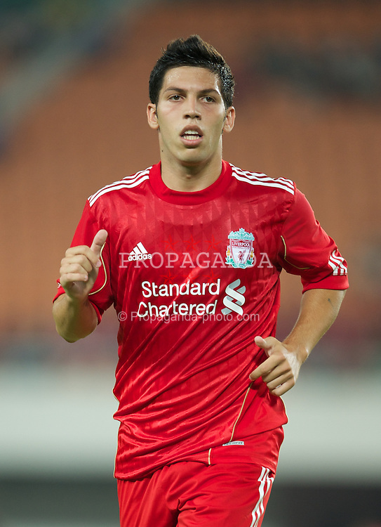 GUANGZHOU, CHINA - Wednesday, July 13, 2011: Liverpool's Daniel Pacheco in action against Guangdong Sunray Cave during the first pre-season friendly on day three of the club's Asia Tour at the Tianhe Stadium. (Photo by David Rawcliffe/Propaganda)