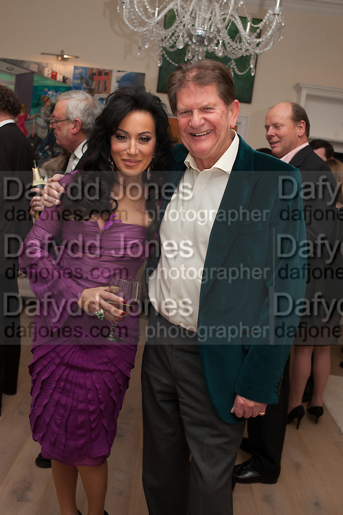 JOHN MADEJSKI,; NANCY DELL D'OLIO,  Drinks party given by Basia and Richard Briggs,  Chelsea. London. SW3. 13 February 2014.