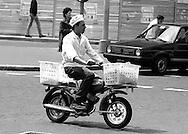 Roma   1985.Garzone in motorino per la consegna della merce.Labourer in moped for the delivery of the commodity