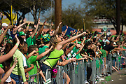 Fans try to catch beads at the Dallas St. Patrick's Parade on Greenville Avenue, Saturday, March 16, 2013. (Cooper Neill/The Dallas Morning News)