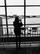 Girl photographing airplanes in the Minneapolis airport.