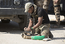 October 23, 2016 - Bartella, Nineveh, Iraq - An Iraqi Army engineer defuses a suicide belt found in a local house in the recently liberated town of Bartella, a mainly Christian town. With a population of around 30,000 people before being taken by the Islamic State in August 2014, the town was liberated two days ago by the Iraqi Army's Counter Terrorism force as part of the ongoing offensive to retake Mosul. Although ISIS militants were pushed back a large amount of improvised explosive devices are still being found in the town's buildings. (Credit Image: © Matt Cetti-Roberts/London News Pictures via ZUMA Wire)