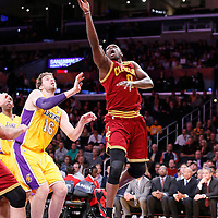 14 January 2014: Cleveland Cavaliers small forward Luol Deng (9) goes for the layup past Los Angeles Lakers center Pau Gasol (16) during the Cleveland Cavaliers 120-118 victory over the Los Angeles Lakers at the Staples Center, Los Angeles, California, USA.