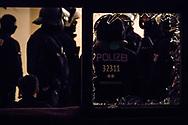 Berlin, Germany - 20.05.2018<br /> <br /> Police eviction of the occupation. With several occupations, activists responded to speculative home vacancy. The biggest action took place in Berlin-Neukoelln. There, a residential building with about 40 apartments was occupied, empty for about 5 years. The building belongs to the state-owned housing company &quot;Stadt und Land&quot;. During the negotiations between representatives of the Berlin Senate, the Stadt und Land&rdquo; and the squatters the police evict the building. The situation on the Berlin housing market is very tense.<br /> <br /> Polizeiliche Raeumung der Besetzungsaktion. Mit mehreren Besetzungen haben Aktivisten an Pfingsten auf spekulativen Leerstand Reagiert. Die groe&szlig;te Aktion fand in Berlin-Neukoelln statt. Dort wurde ein Wohnhaus mit rund 40 Wohnungen besetzt, welche seit etwa 5 Jahren leer stehen. Das Gebaeude gehoert der landeseigenen Wohnungsgesellschaft &rdquo;Stadt und Land&rdquo;. Noch waehrend Verhandlungen zwischen Senatsvertretern, der Stadt und Land und den Hausbesetzern liefen begann in den Abendstunden die polizeiliche Raeumung.  <br /> <br /> Photo: Bjoern Kietzmann