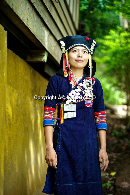 Young girl wearing a Akha Nuqui traditional dress in Laos.  Before it was worn everyday, and now is only for Festivals. It is common in the Phon Sali Province.