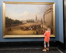 "Woman looking at painting ""Presentation of the Regiment in Potsdam 1817"" by Franz Kruger at Alte Nationalgalerie on Museumsinsel, Berlin, Germany"