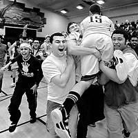 Yuba City High's Taylor Elkins is lifted up by fellow students after defeating crosstown rival River Valley High 72-54 at home on Tuesday, February 12, 2013. (Nate Chute/Appeal-Democrat)