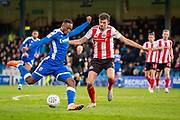 Gillingham FC forward Brandon Hanlan (7) and Sunderland defender Tom Flanagan (12) during the EFL Sky Bet League 1 match between Gillingham and Sunderland at the MEMS Priestfield Stadium, Gillingham, England on 7 December 2019.
