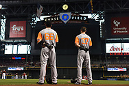 PHOENIX, AZ - AUGUST 27:  Gorkys Hernandez #66 and Kelby Tomlinson #37 of the San Francisco Giants wearing nicklame-bearing jerseys stand for the national anthem for the MLB game against the against the Arizona Diamondbacks at Chase Field on August 27, 2017 in Phoenix, Arizona.  (Photo by Jennifer Stewart/Getty Images)