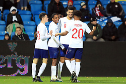 England U21's Dominic Solanke (second right) celebrates scoring his side's third goal of the game with team-mates during the international friendly match at the Blue Water Arena, Esbjerg.