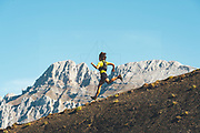 Trail runner jumping downhill in Collado Jermoso, Leon, Spain