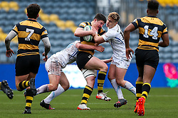 Sam Spink of Wasps U18 is tackled by Gwyn Parks of Exeter Chiefs U18 - Rogan Thomson/JMP - 16/02/2017 - RUGBY UNION - Sixways Stadium - Worcester, England - Wasps U18 v Exeter Chiefs U18 - Premiership Rugby Under 18 Academy Finals Day 3rd Place Play-Off.