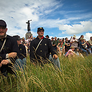 From left, Rex Lichtenfels, of New Florence, Pennsylvania, Wendi Dowler, of Latrobe, PA and David Kukura, of Black Lick, PA await the arrival of the Confederate living historians and participants at the conclusion of the Pickett's Charge Commemorative March,  in front of the 72nd Pennsylvania Infantry Monument, during the Sesquicentennial Anniversary of the Battle of Gettysburg, Pennsylvania on Wednesday, July 3, 2013.  The march was an opportunity to follow in the footsteps of Confederate soldiers by walking with living historians and park rangers along the path of the famously ill-fated Pickett's Charge, which brought to a close The Battle of Gettysburg when the Union Army repelled their advance. The Battle of Gettysburg lasted from July 1-3, 1863 resulting in over 50,000 soldiers killed, wounded or missing.  John Boal Photography