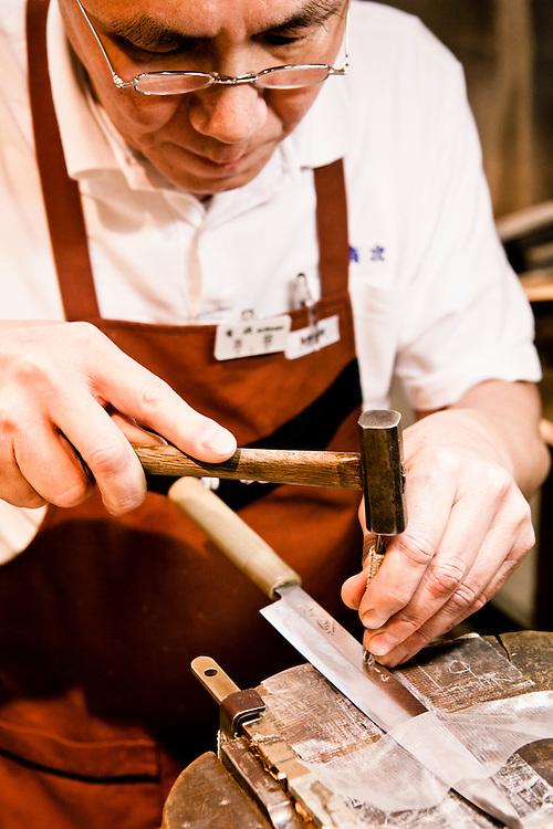 Stamping knives at Aritsugu. Nishiki Market, Kyoto