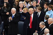President-elect Donald Trump waves standing with Vice President elect Mike Pence as he arrives for the Inaugural Ceremony to become the 45th President on Capitol Hill January 20, 2017 in Washington, DC.
