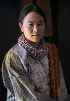 PARO, BHUTAN - CIRCA OCTOBER 2014: Portrait of young Bhutanese woman looking at camera in Bhutan